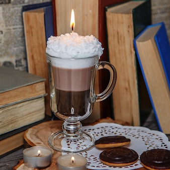 Handmade candle in the form of irish coffee cup with coffee
