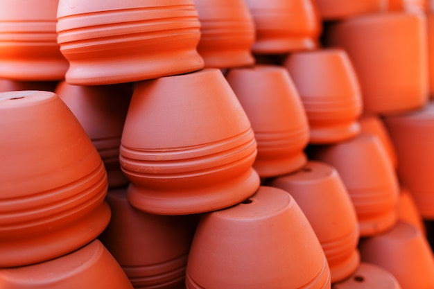 Handmade ceramic crockery made of clay of brown terracotta color