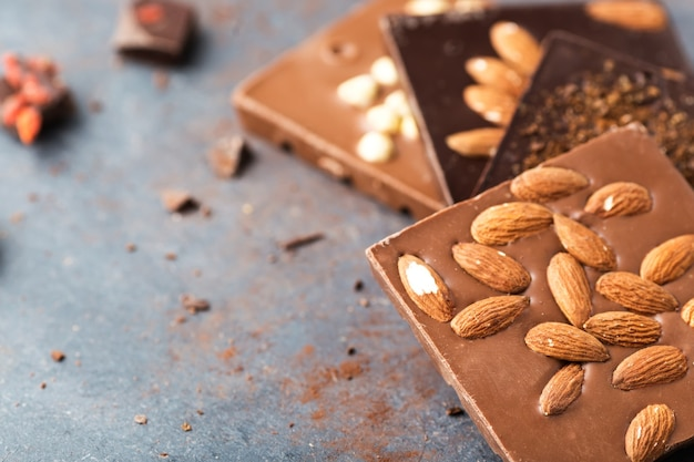 Handmade chocolate bars with nuts and coffee beans