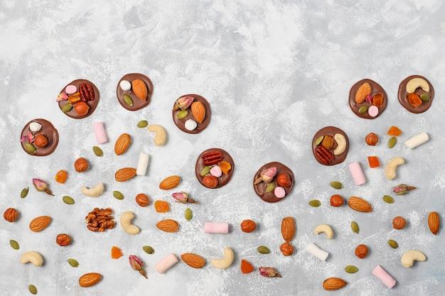 Handmade chocolate mediants, cookies, bites, candies,nuts. copyspace. top view.