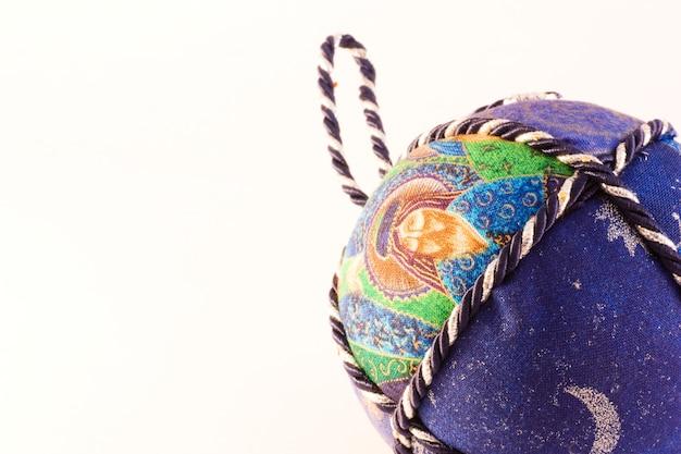 Handmade christmas balls, italian tradition, made of fabric and cord
