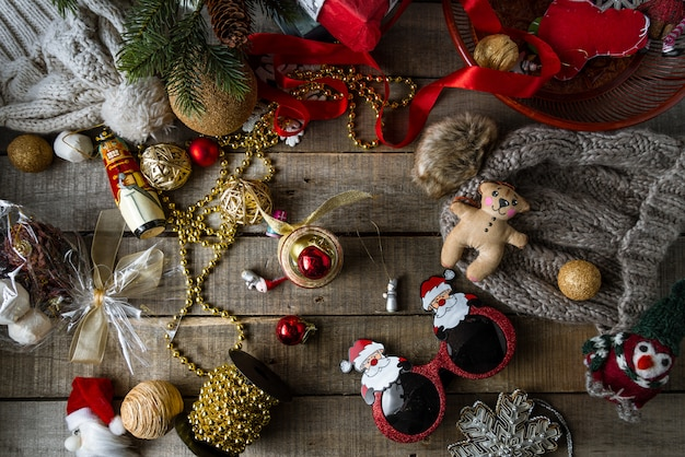 Handmade christmas toys and decorations, warm woolen hats on wood