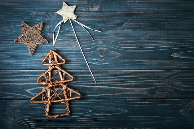 Handmade christmas tree and some decor on wooden table background