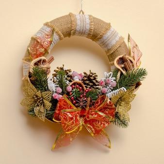 Handmade christmas wreath on the wall, christmas background
