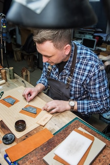 Handmade craft production of leather goods.