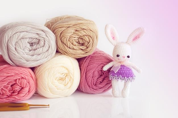 Handmade crochet doll. cute rabbit doll on white background.