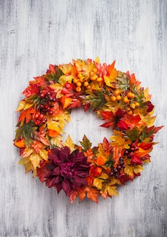 Handmade diy artificial autumn wreath decoration with leaves berry flower