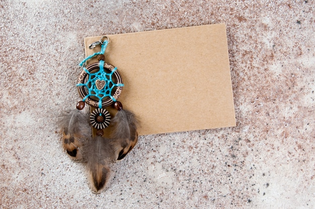 Handmade dream catcher and kraft envelope