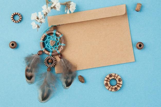 Handmade dream catcher and kraft envelope