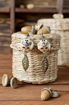 Handmade earrings. glass owl figures are made by hand. home workshop