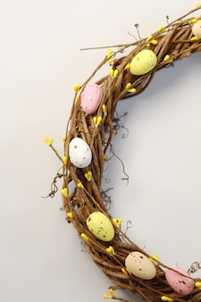 Handmade easter wreath isolated on white background.