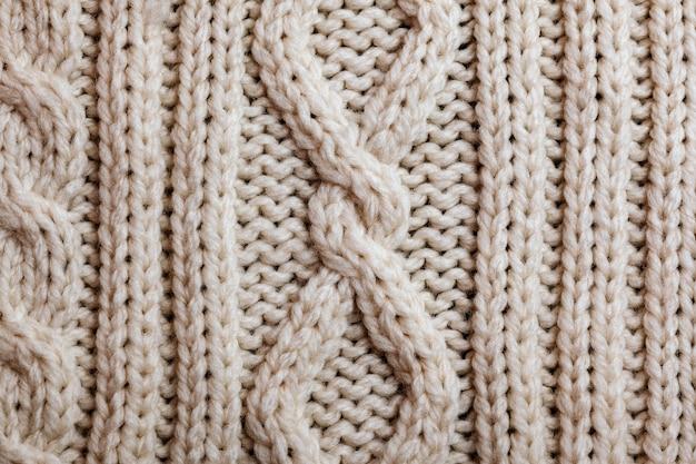 손수 베이지 색 뜨개질 양모 질감 배경