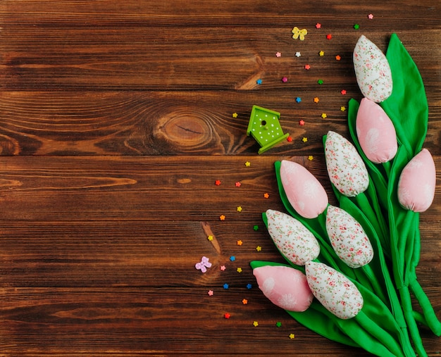 Handmade fabric tulip flowers on rustic wooden background
