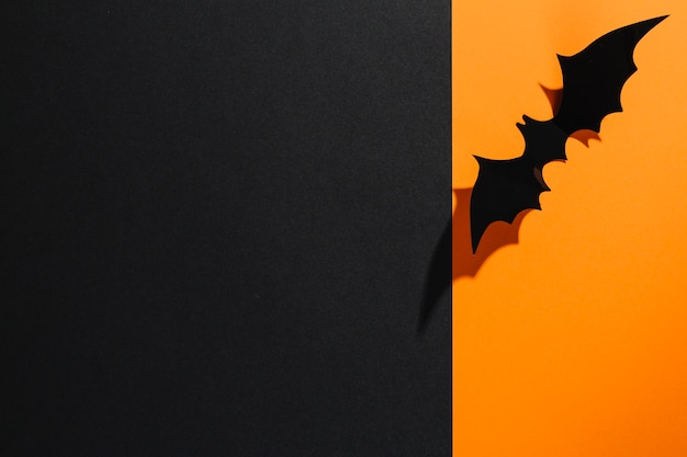 Handmade halloween bat on orange paper