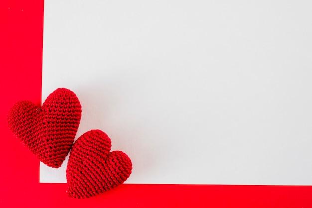 Handmade hearts on paper sheet