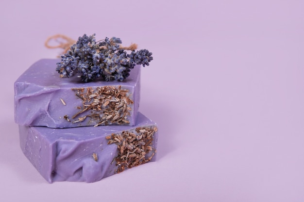 Handmade homemade soap on a lilac background. lavender scent. small business, organic products, natural ingredients.