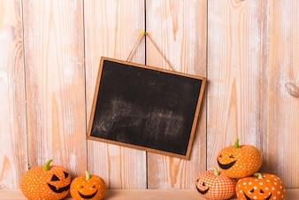 Handmade jack-o-lanterns near chalkboard