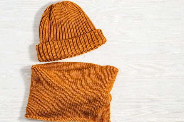Handmade knitted clothing, woolen hat and soft snood ginger colour. warm things for winter season.