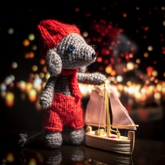 Handmade knitted toy. amigurumi rat toy. crochet stuffed animals. the mouse is crocheted with the ship.