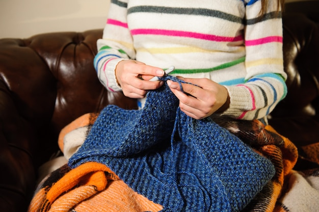 Handmade knitting, leisure woman activity. detail photo