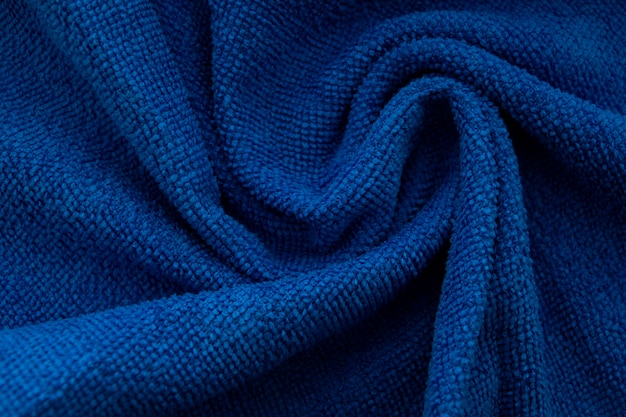 Handmade knitting wool texture background. classic blue pantone color of the year 2020