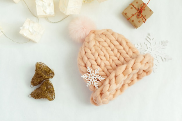 Handmade knitwear composition with warm hat