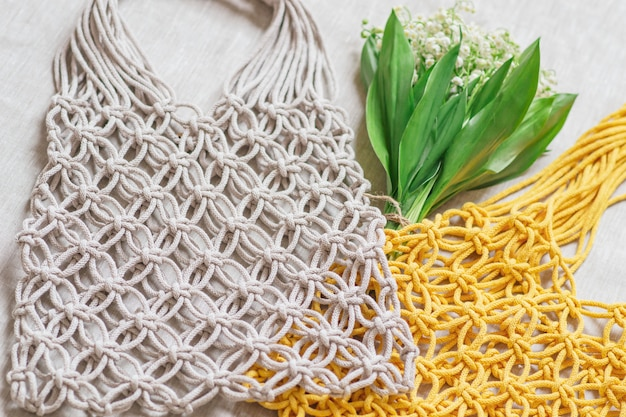 Handmade macrame bag on background