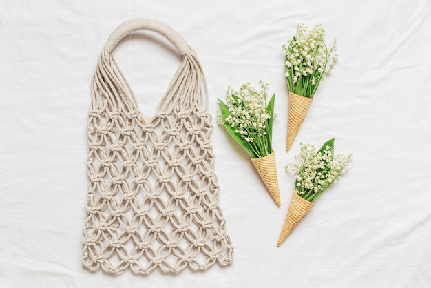 Handmade macrame bag on linen background