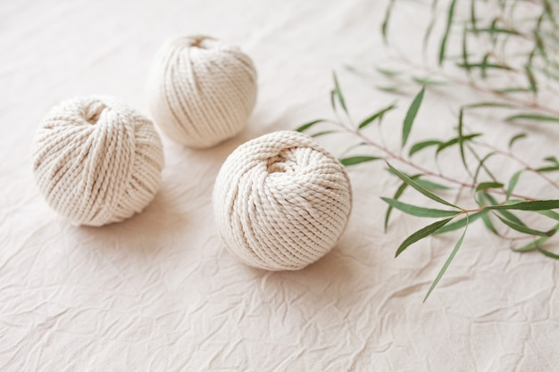 Handmade macrame braiding and cotton threads. image good for macrame and handicrafts banners and advertisement.  top view. copy space
