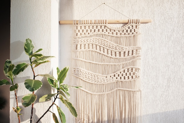 Handmade macrame wallhanging cotton threads  eco friendly modern knitting in the interior