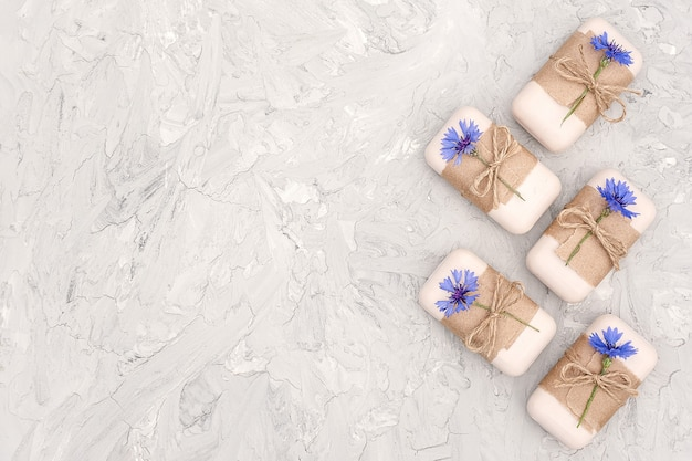 Handmade natural soap set decorated with craft paper and blue flowers