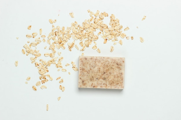 Handmade oatmeal soap on a white background. top view
