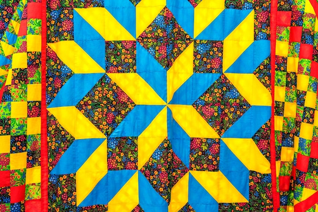 Handmade product made of natural fabric a patchwork bedspread made of multicolored pieces of fabric