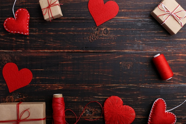 Handmade red felt hearts, gifts and ropes with threads