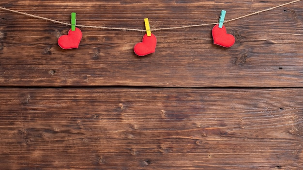 Handmade red heart attached to the rope using clothes pin. valentine's day card