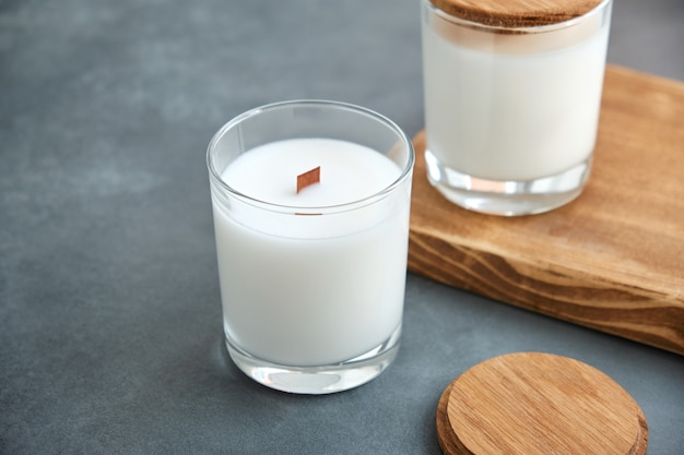 Handmade scented candles in a glass with a wooden lid