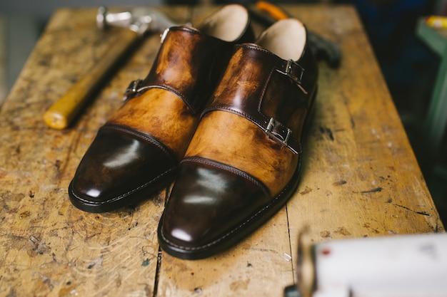 Handmade shoes in shoemaker's workshop.