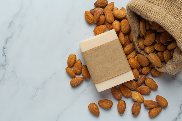 Handmade soap almond on marble background