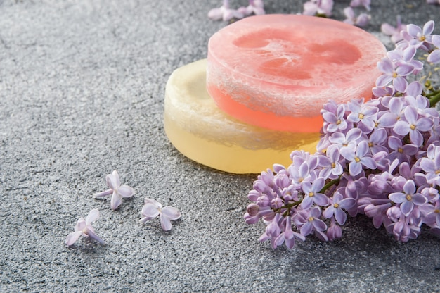 Handmade soap scrub and lilac flowers