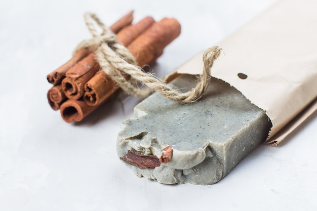 Handmade soap with cinnamon on white background