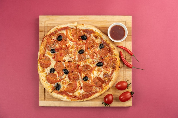Handmade traditional pizza on red table