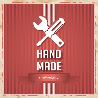Handmade with icon of crossed screwdriver and wrench and slogan on red striped background. vintage concept in flat design.