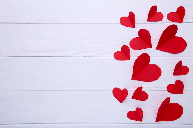 Handmaded red hearts on white background.