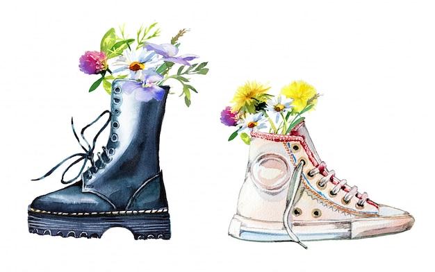 白い壁に分離された野の花の花束と手書きの軍隊のブーツ。