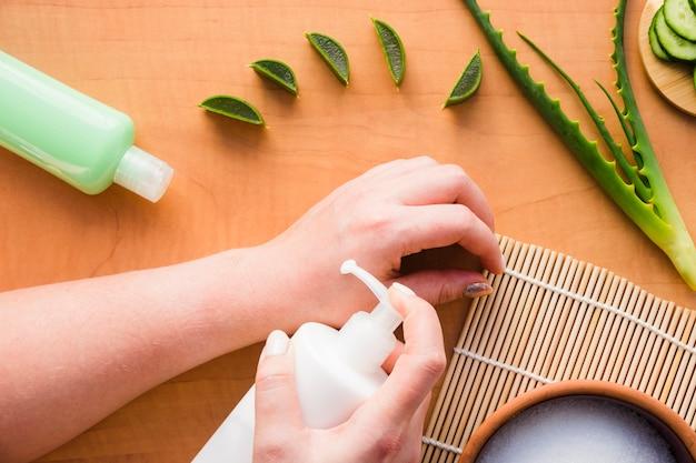 Hands applying aloe vera cream