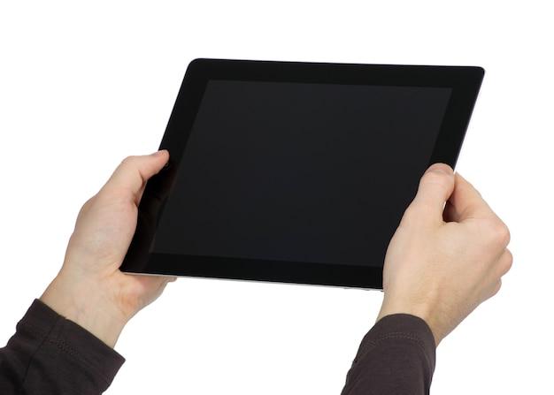 손이 터치 스크린 장치를 잡고 있습니다.