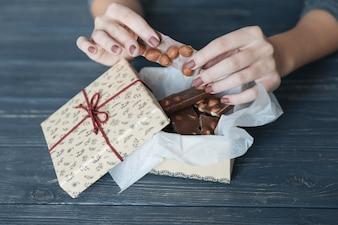Hands breaking chocolate