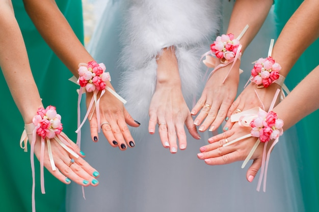 Hands of the bride and bridesmaids