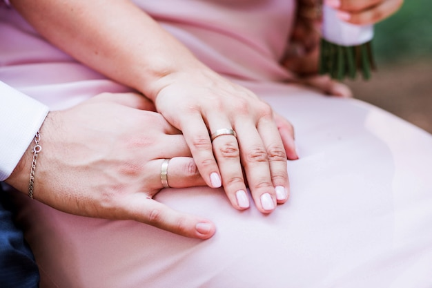 Hands of the bride and groom together. close-up