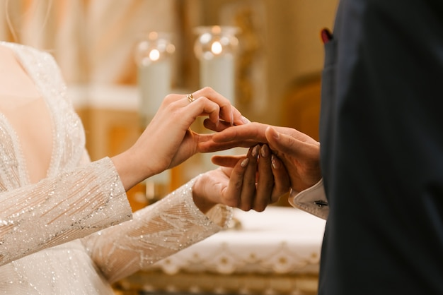 Hands of the bride and groom